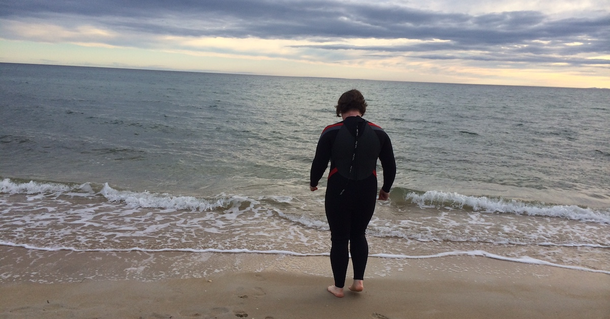 Phillipa at the beach in a wetsuit to combat the suffering of TSW
