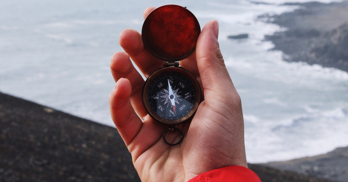 Person navigating with a compass