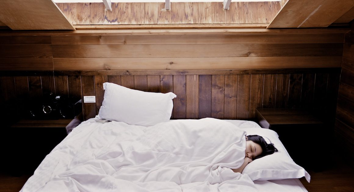 Woman sleeping in bed; sleep